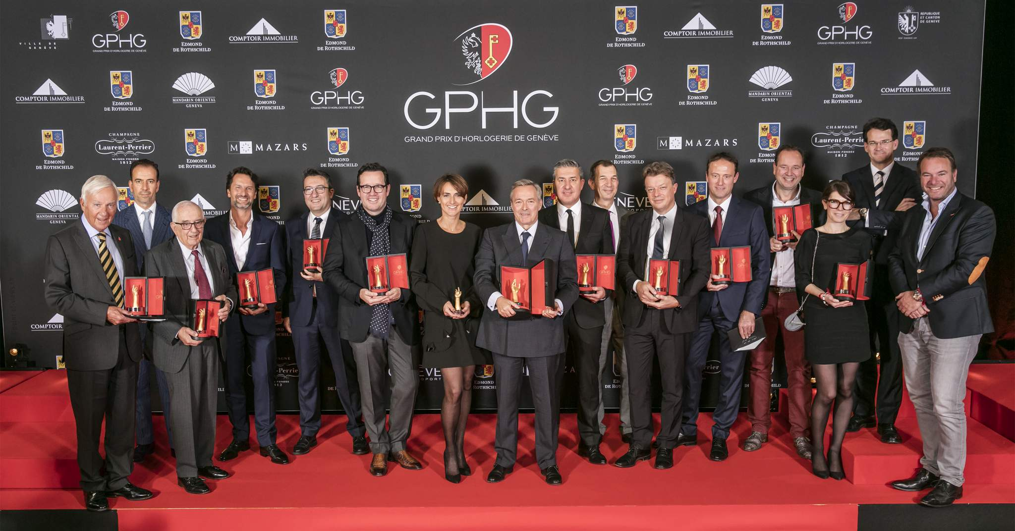The Prize winners of the Grand Prix d'Horlogerie de Genève 2016 : David Newman (President of The George Daniels Educational Trust), Mario Peserico (CEO of Eberhard & Co), Jack Heuer (Honorary Chairman of TAG Heuer), Maximilian Büsser (Owner & Creative Director of MB&F), Xavier de Roquemaurel (CEO of Czapek Genève), François Bennahmias (CEO of Audemars Piguet), Delphine Favier (Managing Director of Montblanc Suisse), Karl-Friedrich Scheufele  (President of Chronométrie Ferdinand Berthoud), Antonio Calce (CEO of Girard-Perregaux), Philippe Léopold-Metzger (CEO of Piaget), Nicolas Beau (International Watch Director of Chanel), Eric Pirson (Director of Tudor), Tim and Bart Grönefeld (Co-founders of Grönefeld), Aurélie Picaud and Sean Gilbertson (Timepieces Director and CEO of Fabergé)