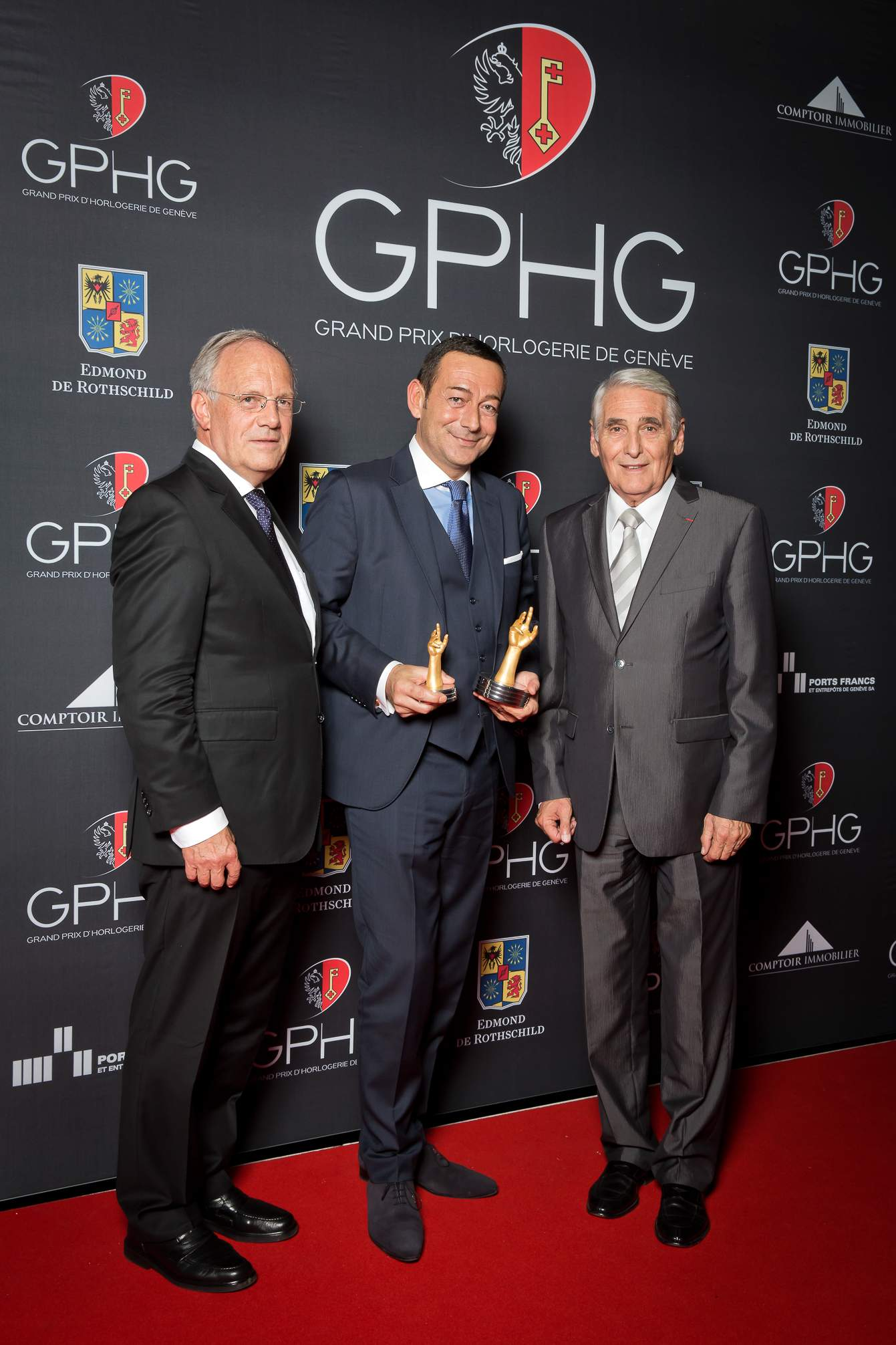 Johann Schneider-Ammann (Federal councillor), Jean-Charles Zufferey (Vice-president of Breguet, winner of the « Aiguille d'Or » Grand Prix 2014) and Carlo Lamprecht (President of the Foundation of the GPHG)