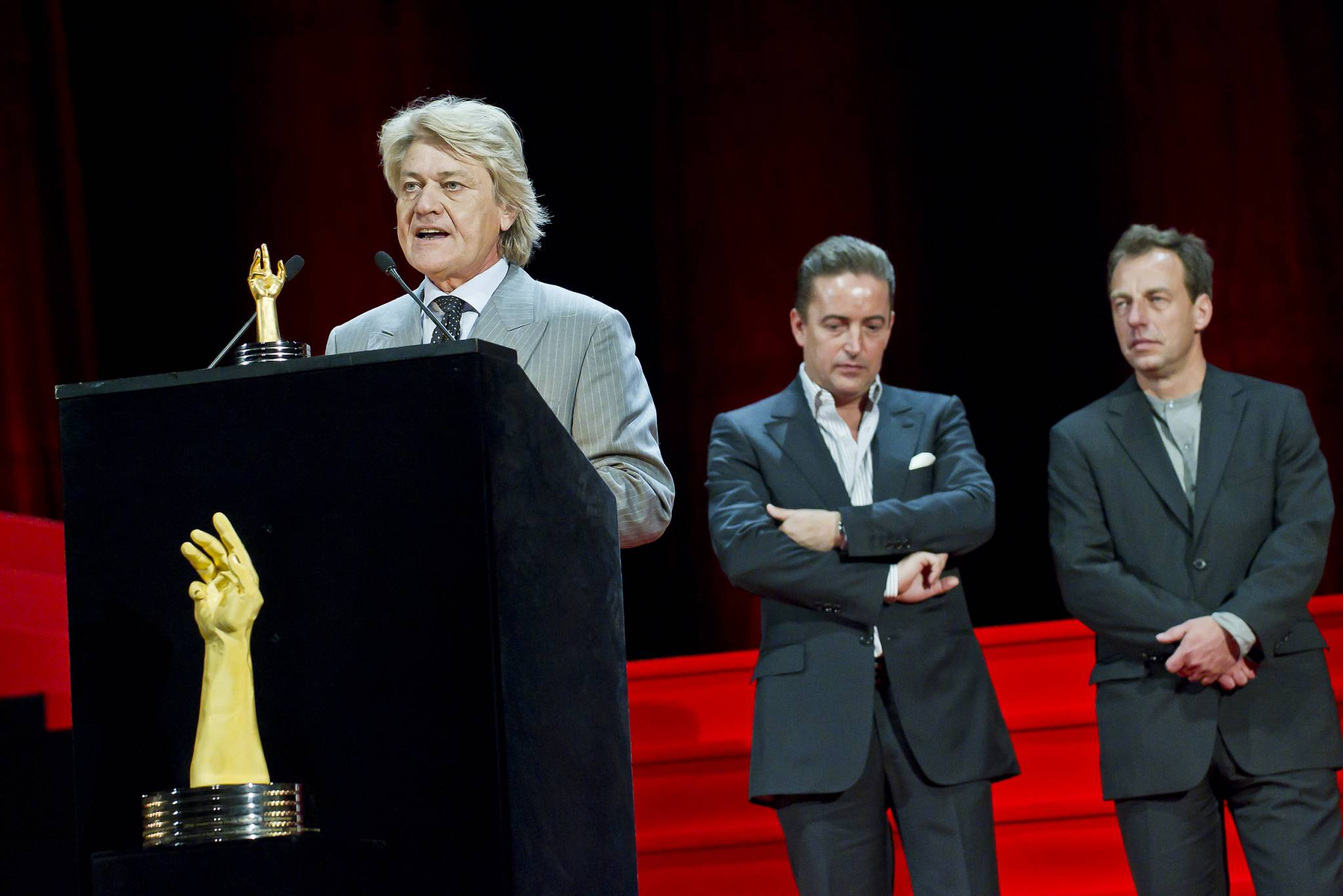David Zanetta, co-founder of the De Bethune brand, winner of the 2011 Aiguille d'Or Grand Prix, accompanied by Pierre Jacques and Denis Flageollet