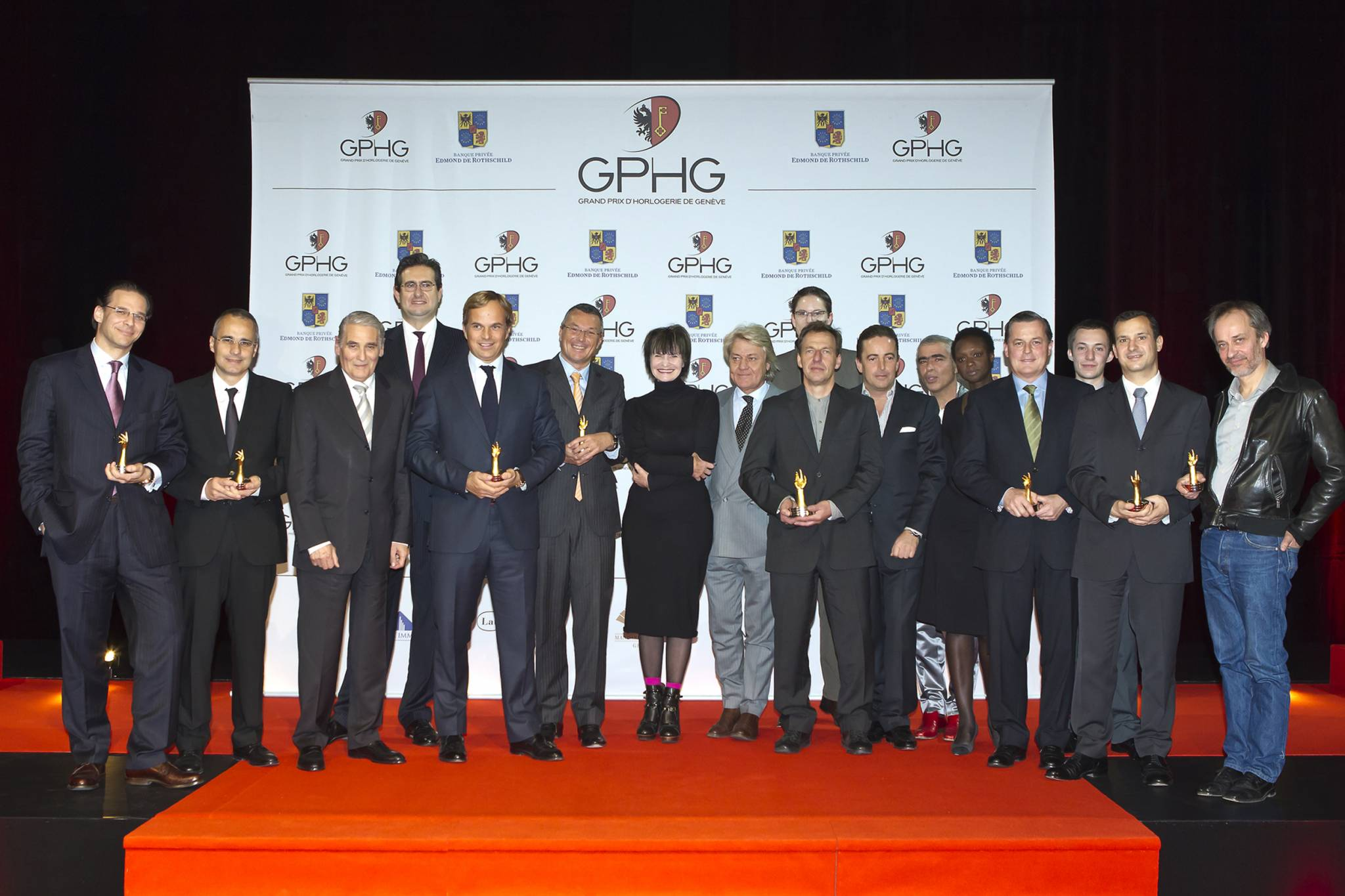 Alexander Schmiedt (Director of Watchmaking, MontBlanc), Jean-Christophe Sabatier (Director of Watchmaking, Boucheron), Carlo Lamprecht (President of the GPHG Foundation), Luc Perramond (CEO of TAG Heuer), Micheline Calmy-Rey (President of the Swiss Confederation), David Zanetta (Co-founder of De Bethune), Philippe Merk (CEO of Audemars Piguet), Eric de Rocquigny (Director of Métiers, Van Cleef & Arpels), Vianney Halter and at the back, wearing glasses: Cyrano Devanthey (engineer-constructor at Urwerk), November 19th, 2011